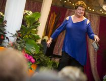Lynn Jones walks the catwalk during the Canmore Mountain Grannies' first-ever fashion show fundraiser, held at the Mountain Lady's Greenhouse in 2014. The event raised more than $6,000 for the Stephen Lewis Foundation, which supports grandmothers caring for their orphaned grandchildren in AIDS-stricken regions of Africa. Justin Parsons/ Crag Canyon/ QMI Agency