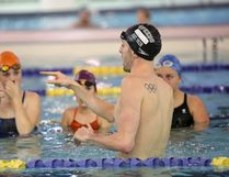 Olympian Ryan Cochrane coaches 30 swimmers from Canadian Badlands Aquatic Club and Olds Rapids Swim Club at Genesis Place on Tuesday, Oct. 11, 2016 in Airdrie, Alta. The 27-year-old distance freestyle swimmer is doing a tour across Canada to smaller clubs he had never visited before. Britton Ledingham/Airdrie Echo/Postmedia Network