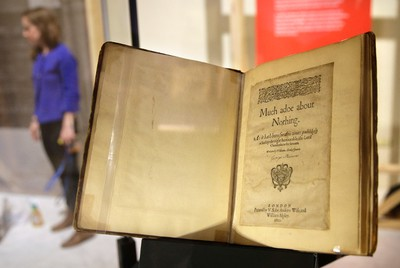 """In this Tuesday, Oct. 11, 2016 photo a 1600 edition of Shakespeare's play """"Much Ado About Nothing"""" rests in a display case as part of the exhibit """"Shakespeare Unauthorized""""  at the Boston Public Library, in Boston. The public is to get a rare glimpse of first and early editions of some of Shakespeare's most beloved plays, including """"A Midsummer Night's Dream,"""" Hamlet"""" and """"The Merchant of Venice,"""" in the upcoming exhibit which is to open Friday, Oct. 14 and and run through March 31 at the library. (AP Photo/Steven Senne)"""