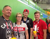 Blair Nesbitt, 24, stands with his family during the Paralympics in Brazil. - Photo submitted