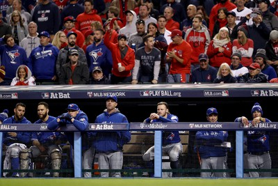 The Toronto Blue Jays react from the dugout against the Cleveland Indians during Game 1 of the American League Championship Series at Progressive Field on Oct. 14, 2016 in Cleveland, Ohio. (Maddie Meyer/Getty Images)