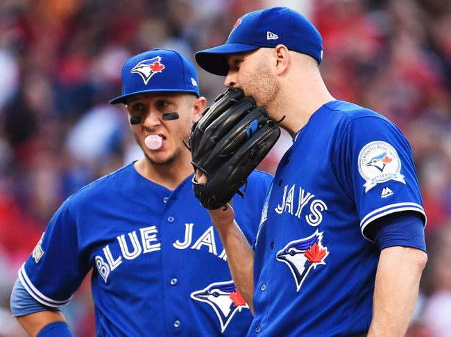 Toronto Blue Jays starting pitcher J.A. Happ stands on the mound as teammate Troy Tulowitzki looks on against the Cleveland Indians during fifth inning of Game 2 in the American League Championship Series in Cleveland on Oct. 15, 2016. (THE CANADIAN PRESS/Nathan Denette)