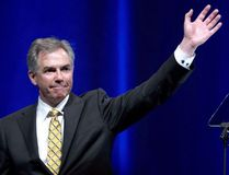 Outgoing Premier Jim Prentice waves after his speech at the Alberta PC Dinner in Calgary, Alberta on Thursday May 14, 2015. According to media reports former Alberta premier Prentice died Thursday in a plane crash outside of Kelowna, British Columbia. THE CANADIAN PRESS/Larry MacDouga