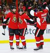 Senators forward Zack Smith (left) is congratulated by teammates Chris Wideman (centre) and Mark Borowiecki after scoring on Oct. 15 against the Montreal Canadiens. (Errol McGihon, Ottawa Sun)
