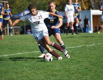 Laurentian Voyageurs' Catherine Rocca tries to defend Ottawa Gee-Gees' Morgan McNeil during OUA women's soccer at the LU soccer fields on Sunday. The Voyageurs won 2-1. Keith Dempsey/For The Sudbury Star