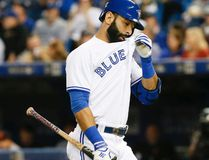 Blue Jays right fielder Jose Bautista has yet to get a hit against the Indians in the American League Championship Series. (Stan Behal/Toronto Sun)