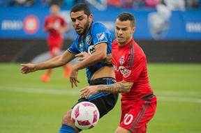 Montreal Impact's Victor Cabrera, (left) challenges Toronto FC's Sebastian Giovinco in a 2-2 draw in Montreal yesterday. (The Canadian Press)