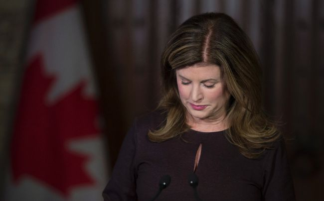 Opposition leader Rona Ambrose pauses as she makes a brief statement following the death of former Conservative MP and Alberta Premier Jim Prentice Friday, October 14, 2016, on Parliament Hill in Ottawa. Prentice was killed after a plane he was travelling on crashed in B.C. THE CANADIAN PRESS/Adrian Wyld