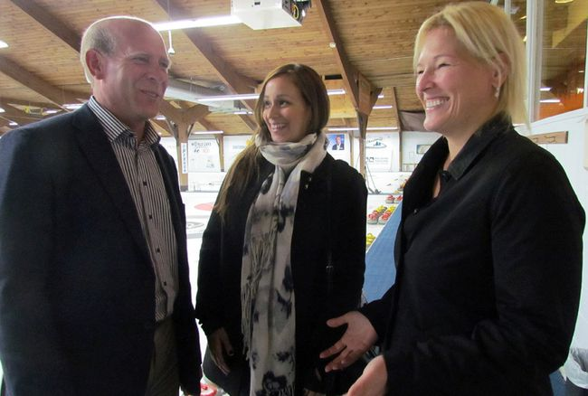 Olympic curling gold medalist Kevin Martin, Jennifer Kjell (centre), Grand Slam of Curling events manager, and Kristi Petrushchak, Grand Slam of Curling manager, discuss the upcoming event slated for Dec. 6-11 at Essar Centre prior to a meet and greet Monday at Community First Curling Centre.