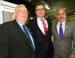 Ernst Kuglin/The Intelligencer Quinte West Mayor Jim Harrison, Chris Palin of the Business Development Bank of Canada and Belleville Mayor Taso Christopher attend Tuesday's breakfast meeting held at the National air Force Museum of Canada. The breakfast attracted more than 300 business leaders and municipal officials.