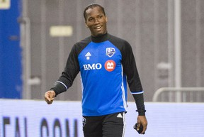 Montreal Impact's Didier Drogba smiles as he arrives for a training session in Montreal on March 1, 2016, ahead of the Impact's season opener against the Vancouver Whitecaps. (THE CANADIAN PRESS/Graham Hughes)