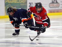 Tristan Giles, right, of the Grande Prairie Panthers, is taken down from behind by Marilyn Robichaud, of the Sturgeon Lake Chill, in Peace Country Female Hockey League play on Sunday Oct.16 at the Crosslink County Sportsplex. The Panthers are icing another strong team this season, according to head coach Kyle Chapple. Logan Clow/Daily Herald-Tribune