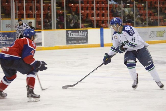 The Melfort Mustangs' Dakota Boutin tries to find a shot past a Melville Millionaires defender during the Mustangs 3-2 victory on Saturday, October 15 at the Northern Lights Palace.