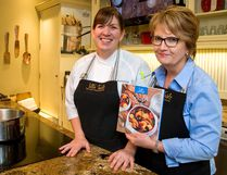 Jill Wilcox right, has written a new cookbook called Jill's Soups, Stews & Breads, with co-author Josie Pontarelli, left, and input from sommelier Christie Pollard. (MIKE HENSEN, The London Free Press)