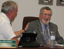 Coun. Allan Wren shares a laugh with Jim Sheedy, right, during Sheedy's final meeting as part of Laurentian Valley council on Tuesday. Sheedy announced on Sept. 30 he was resigning as councillor after over 40 years of public service in the area.
