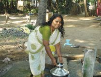 A woman from an impoverished family in South India. She has recently built water facilities through a microfinance loan she received from our Field Partner.