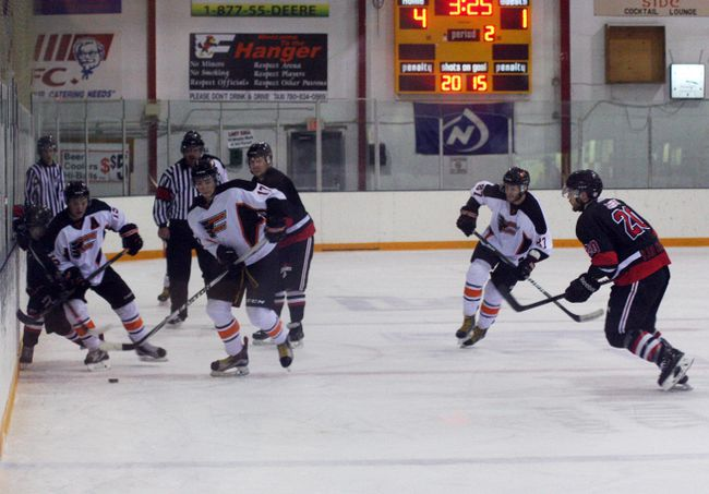 With the Flyers leading the Beaverlodge Blades 4-1 in the second period, Trevor Tokarz (#15) and Zac Schlachter (#17) move the puck up the ice for a goal attempt with Kevin Yasinski (#87) following as backup.
