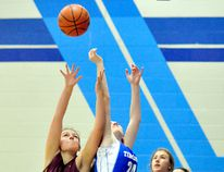 Celeste Deforge, left, of the École secondaire catholique Thériault Flammes, and Natashia Van De Kraats, of the Timmins High & Vocational School Blues, go up for a rebound during a NEOAA Central Division Senior Girls Basketball game TH&VS Tuesday evening. Looking on are Hunter Million, of the Blues, and Kiara Lee, of the Flammes. The Flammes jumped out to a 17-0 first-quarter lead and never looked back as they went on to post a 52-20 victory. THOMAS PERRY/THE DAILY PRESS