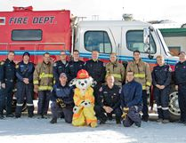 Members of the Peace River and County of Northern Lights Fire Departments pose for a photo on Saturday October 15, 2016 in Peace River, Alta.