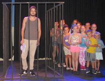"""""""Poor, poor, Joseph"""" (Dylan Trahan) """"locked up in a cell"""" with the children's chorus around him trying to give him encouragement during Kincardine Theatre Guild's recent Joseph rehearsals. The children's chorus is made up of 21 young people from the area, ages 7-14. The play runs Nov. 17-Dec. 3, 2016. (Shared photo)"""
