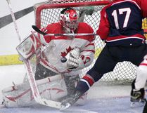 Team Canada West goalie Kevin Gonoe makes a save during the third period of the gold-medal game of the World Junior A Championship at the ENCANA arena in Camrose in 2008.