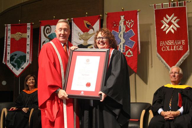 Fanshawe College President Peter Devlin presents Kelly Gilson with an honorary diploma at the 2016 graduation ceremony for Fanshawe College's Woodstock campus on Wednesday, October 19, 2016. (MEGAN STACEY/Sentinel-Review)