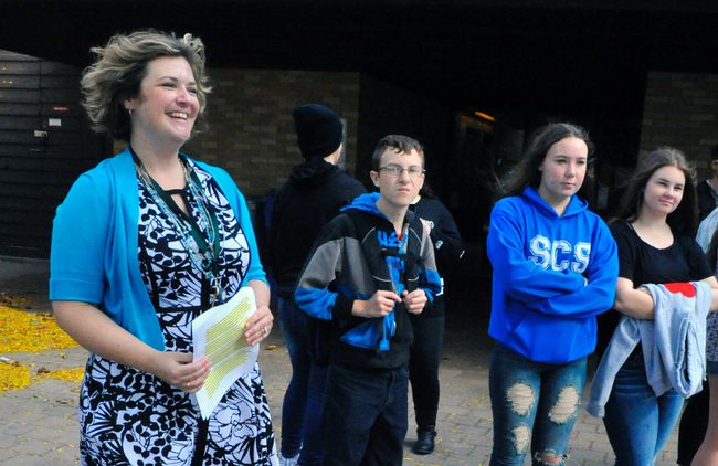Jill Binkley (left), deputy clerk of Norfolk County, leads a group of Simcoe Composite School students during a tour of town hall on Tuesday to celebrate Local Government Week. With her are students Floyd Feere, 16, Cherry Carson, 15, and Cassidy Badger, 15. DANIEL R. PEARCE/SIMCOE REFORMER