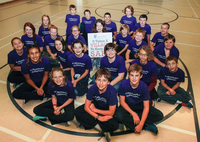 "The students in Ryan Borges's Grade 7/8 class at J.J O'Neill Catholic School in Napanee help to spread the message that ""It takes a village to keep kids safe,"" as part of the #ibreakthesilence chid abuse awareness campaign for the month of October. (Julia McKay/The Whig-Standard)"
