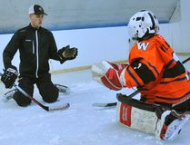 Thomas Shelley of Post 2 Post Goalie Training works with Jack Millard, 10, of Port Dover at the Sniper's Den in Simcoe. Shelley, a Waterford native, has become a sought after goalie coach since developing the Post 2 Post model. JACOB ROBINSON/SIMCOE REFORMER