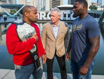 Tom Wright (centre) is flanked by UFC light heavyweight champion Daniel Cormier (left) and Anthony Johnson (right) at Nathan Phillips Square in Toronto on Tuesday, Oct. 18, 2016. Wright, UFC Executive VP and GM, Canada, Australia & New Zeland, was one of many employees let go at the UFC's office in Toronto. (Ernest Doroszuk/Toronto Sun)