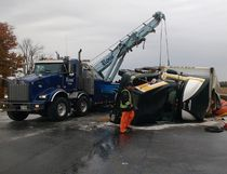 A tractor trailer overturned on the 401 before 6 a.m. Thursday morning, blocking the busy highway's westbound lanes near Woodstock and spilling fuel. The crash forced the detour of morning commuter traffic into Woodstock. Megan Stacey/Woodstock Sentinel Review/Postmedia Network