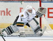 Tyler Parsons #1 of the London Knights gets set to face a shot against the Windsor Spitfires during an OHL game at Budweiser Gardens on October 14,2016 in London, Ontario, Canada. The Knights defeated the Spitfires 4-0. (Photo by Claus Andersen/Getty Images)