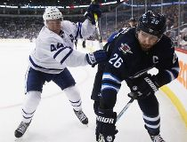 Toronto Maple Leafs' Morgan Rielly (44) checks Winnipeg Jets' Blake Wheeler (26) during second period NHL action in Winnipeg on Wednesday, October 19, 2016. THE CANADIAN PRESS/John Woods