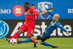 TFC's Jozy Altidore dribbles the ball past Montreal defender Laurent Ciman last week. (THE CANADIAN PRESS)