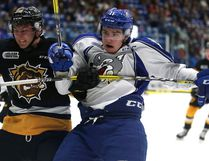 Hamilton Bulldogs Cole Candela and Sudbury Wolves Alan Lyszczarczyk battle for position during OHL action from the Sudbury Community Arena in Sudbury, Ont. on Friday October 14, 2016. Gino Donato/Sudbury Star/Postmedia Network