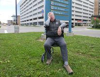 Michael Laliberte, who has been waiting five months to get the proper drug injections to relieve pain that has left him using a walker, sits outside of LHSC's Victoria Hospital campus. Craig Glover/The London Free Press/Postmedia Network