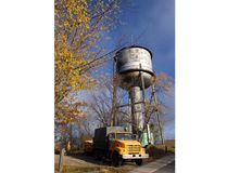 City work crews arrive on site Thursday, Oct 20 to clear brush and trees from the area in preparation for the water tower demolition project scheduled to proceed next week. REG CLAYTON/Miner and News