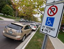 A sign on a post identifies this Dufferin Avenue parking spot, near the corner of Richmond Street, is for drivers with a disability permit, in London, Ont. on Tuesday October 18, 2016. Rick Gleed believes the space needs more than minimum signage, such as markings on the pavement, as the space generates many tickets. Craig Glover/The London Free Press/Postmedia Network