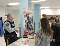 Const. McKenna of the Edson RCMP answers student questions during the Parkland Composite High School Career Fair on Oct. 18.