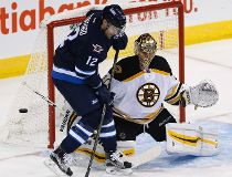 Winnipeg Jets' Drew Stafford's (12) deflection against Boston Bruins goaltender Tuukka Rask (40) goes wide during first period NHL action in Winnipeg on Monday, October 17, 2016. THE CANADIAN PRESS/John Woods   Abort Checkout  Checkin  Save Revision  Edit