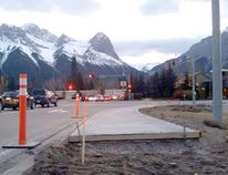 What appears to be a sidewalk extension to a dead-end that is making an impact on social media on Friday, Oct. 21, 2016 is part of new transit infrastructure by the Town of Canmore. The partial sidewalk at the intersection of Bow Valley Trail and Benchlands Trail will serve as an interim bus stop. A crew began paving the new sidewalk extension about one week ago. (Amanda Symynuk/ Bow Valley Crag & Canyon/ Postmedia Network)