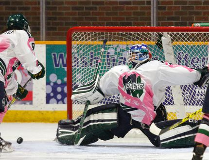 Nipissing Lakers goalie Jackie Rochefort makes a pad save on the Western Mustangs at Memorial Gardens, Saturday. She stopped 27 pucks for a 2-0 shutout. Dave Dale / The Nugget