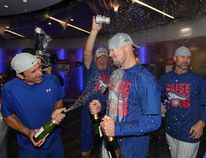 Jon Lester of the Chicago Cubs celebrates in the clubhouse after defeating the Los Angeles Dodgers 5-0 in game six of the National League Championship Series to advance to the World Series against the Cleveland Indians at Wrigley Field on October 22, 2016 in Chicago, Illinois. (Jonathan Daniel/Getty Images)