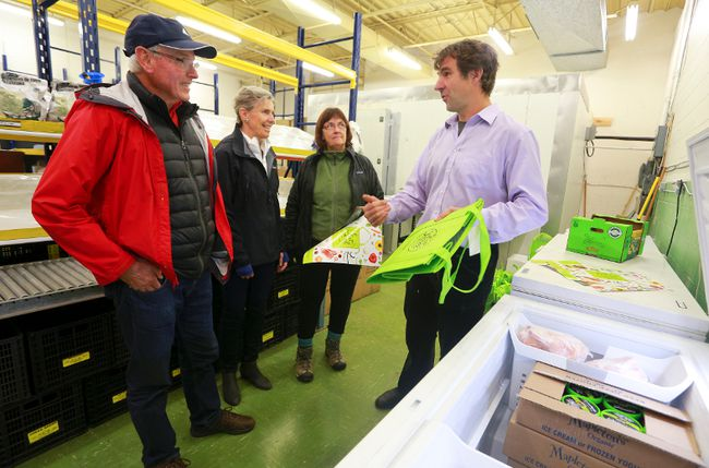Eat Local Grey Bruce general manager Thorsten Arnold, right, speaks with prospective consumer members about the co-op during an open house Saturday in Owen Sound. (JAMES MASTERS/THE SUN TIMES)