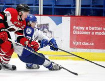 Ryan Orban of the Ottawa 67's and Darian Pilon of the Sudbury Wolves battle for the puck during OHL action from the Sudbury Community Arena in Sudbury, Ont. on Sunday October 23, 2016. Gino Donato/Sudbury Star/Postmedia Network