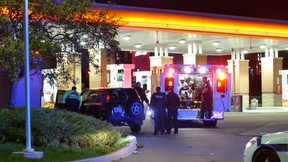 Emergency crews at a gas station near Creditview Rd. and Eglinton Ave. in Mississauga where two men were found with gunshot wounds.  Deshawn Brandon Nicholson was murdered nearby in a shooting. Police have not yet connected the two incidents. 2016. (Pascal Marchand/Special to the Toronto Sun)