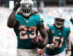 Dolphins running back Jay Ajayi (23) celebrates a touchdown during second half NFL action against the Bills in Miami Gardens, Fla., on Sunday, Oct. 23, 2016. (Wilfredo Lee/AP Photo)