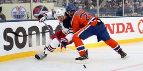 Darnell Nurse checks Winnipeg Jets' Shawn Matthias during second-period action Sunday at the Heritage Classic in Winnipeg. (The Canadian Press)