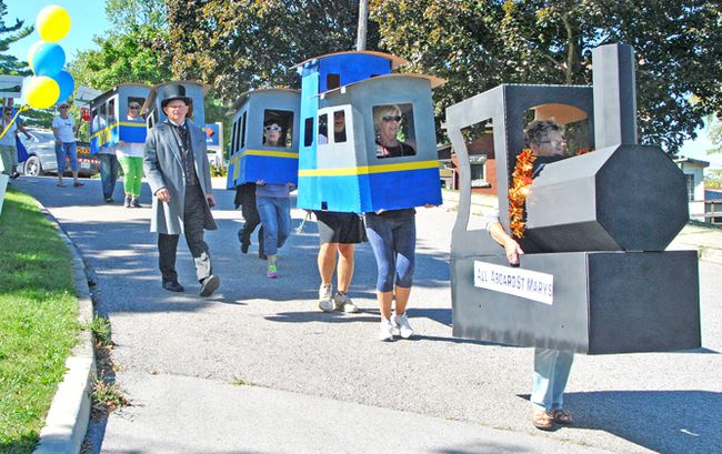 Supporters of the citizens group All Aboard St. Marys complete a protest march through town at the VIA Rail station in September of this year. STEVE RICE/ The Beacon Herald