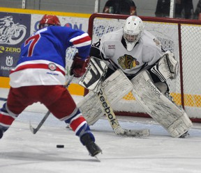 Mitchell Hawks' goalie Graeme Lauersen (30) coolly stands his ground as Kincardine's Dalton Hnatko (7) comes in on a partial shorthanded breakaway in the third period. Lauersen was up to the challenge on this play, backstopping a 3-1 win. ANDY BADER MITCHELL ADVOCATE